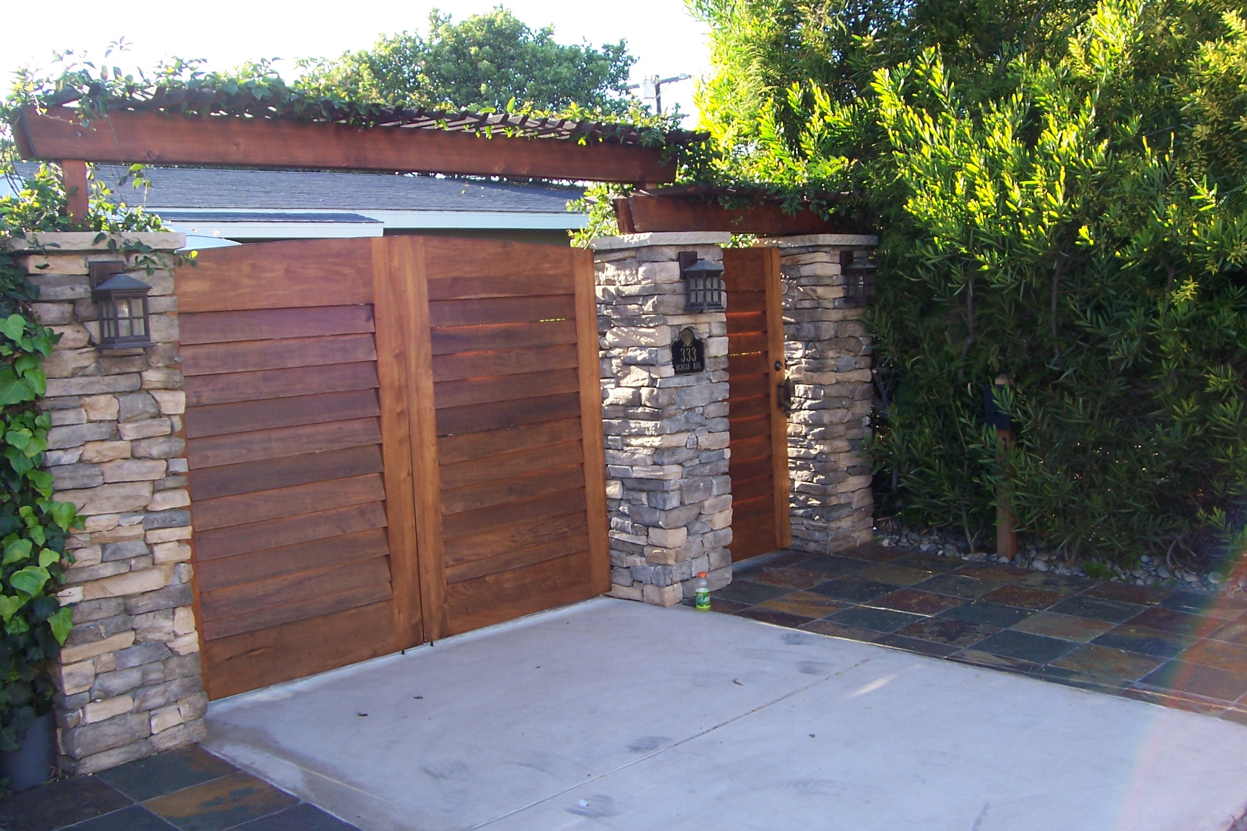 Gate Design With Wooden Driveway And People Gates